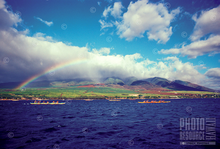 Rainbow over West Maui mountains,  canoe paddlers on ocean, near Lahaina
