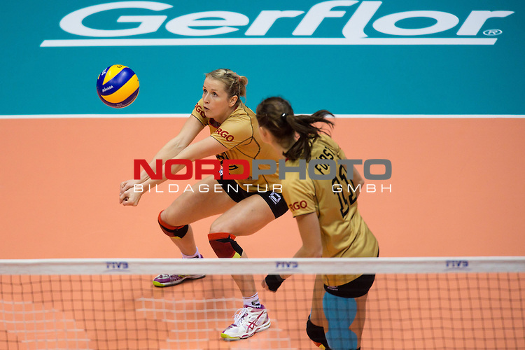 05.10.2014, Pala Trieste, Triest<br /> Volleyball, FIVB Volleyball Women`s World Championship 2014, 2. Runde, Deutschland (GER) vs. Aserbaidschan (AZE)<br /> <br /> Annahme Heike Beier (#12 GER), Christiane F&uuml;rst / Fuerst (#11 GER)<br /> <br />   Foto &copy; nordphoto / Kurth