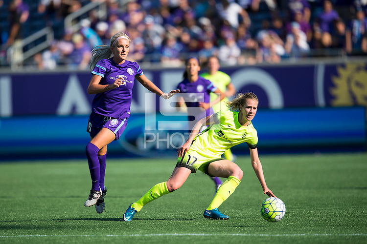 Orlando, Florida - Sunday, May 8, 2016: Orlando Pride midfielder Kaylyn Kyle (6) pressures Seattle Reign FC forward Beverly Yanez (17) as she makes a pass and stumbles during a National Women's Soccer League match between Orlando Pride and Seattle Reign FC at Camping World Stadium.