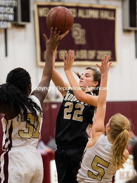 WATERBURY, CT- 11 January 2015-011116EC09-    Woodland's Morina Bojka takes a shot between Sacred Heart's Nehway Sahn and Kayleigh O'Donnell Monday night. Erin Covey Republican-American