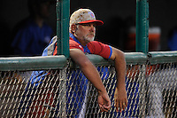 Bruce Walton #18 of the Iowa Cubs, watches his pitchers from the dugout against the Omaha Storm Chasers at Principal Park on July 2, 2014 in Des Moines, Iowa. The Cubs  beat Storm Chasers 4-3.   (Dennis Hubbard/Four Seam Images)