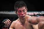 Hatsu Hioki of Japan and Ivan Menjivar of Canada fight on their Lightweight Bout 3 Rounds during the UFC Fight Night at the Cotai Arena on 01 March 2014 in Macau, China. Photo by Victor Fraile / Power Sport Images