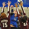 Amanda Goldstein #13 of Centereach, center, goes up for a spike attempt during a non-league varsity girls volleyball match against Whitman at New York Institute of Technology in Old Westbury on Wednesday, Sept. 20, 2017.