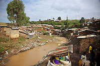 A heavily polluted river runs through one sector of the Kibera slum. Kibera is the largest slum in Kenya, and the second largest in Africa, with an estimated population of over 1 million people. This river is used indiscriminately as both a sewer and a wash basin.
