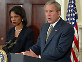 Washington, D.C. - May 8, 2006 -- United States President George W. Bush discusses the situation in Darfur, Sudan, in the Roosevelt Room of the White House on May 8, 2006. United States Secretary of State Condoleezza Rice looks on from left. United States Deputy Secretary of State Robert Zoellick recently returned from Sudan where he helped put together a tenuous peace plan.  Bush said he was sending Rice to the United Nations on Tuesday to urge the Security Council to pass a resolution to seed the deployment of United Nations (U.N.) peacekeeping troops in Darfur to protect residents from further violence. He also said he had directed the acceleration of food and humanitarian assistance to Darfur and urged congress to approve an extra $225 million more in food aid as part of its emergency spending bill.<br /> Credit: Roger Wollenberg - Pool via CNP