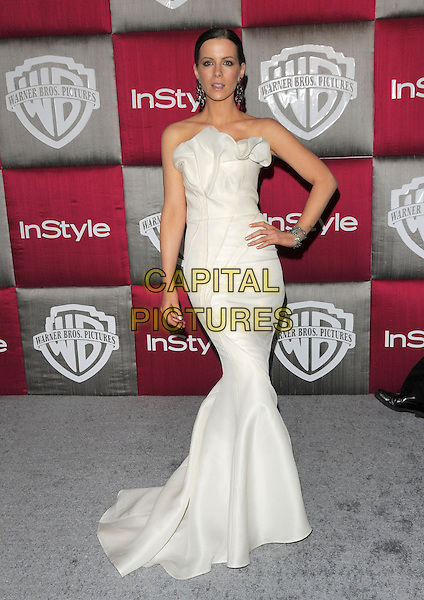 KATE BECKINSALE .The 10th Annual Instyle & WB Golden Globes After Party held at Oasis Court in The Beverly Hilton Hotel in Beverly Hills, California, USA..January 11th, 2009.full length silk satin strapless long white dress hand on hip fishtail .CAP/DVS.©Debbie VanStory/Capital Pictures.