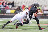 College Park, MD - November 26, 2016: Maryland Terrapins quarterback Perry Hills (11) gets tackled during game between Rutgers and Maryland at  Capital One Field at Maryland Stadium in College Park, MD.  (Photo by Elliott Brown/Media Images International)