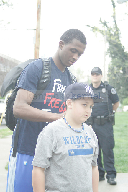 UK guard Doron Lamb signs an autograph for a fan before he gets on the bus to leave for New Orleans for the Final Four game in Lexington, Ky. on March 28, 2012. Photo by Quianna Lige | Staff