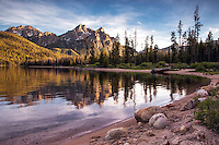 Evening reflection of Mount McGowen of the Sawtooth Mountain Range in the calm waters of Stanley Lake