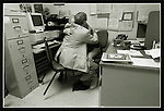 Intern chaplain Shaw Whitney consoles with head administrator Bob Walter over a  death he as a chaplain witnessed in the Intensive Care Unit growth San Francisco General Hospital, California.