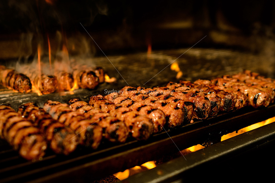 Croatian Sausages, Cevapcici, Cevaps, on a grill with flames