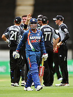Virendar Sehwag walks from the crease after being dismissed by Ian Butler during the 2nd ODI cricket match between the New Zealand Black Caps and India at Westpac Stadium, Wellington, New Zealand on Friday, 6 March 2009. Photo: Dave Lintott / lintottphoto.co.nz