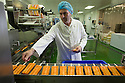 "19/06/16<br /> <br /> Nick Tanzarella, production manager, checks quality on production line.<br /> <br /> <br /> ""The last couple of days have sent the factory into meltdown,"" exclaimed Pasquale Tanzarella, director of one of the UK's largest independent ice-lolly manufacturers.<br /> <br /> In fact, today alone, his factory will make more than 200,000 ice lollies, which will be sold up and down the country through traditional ice-cream vans and shops. <br /> <br /> Demand has been so high because of the recent hot spell that the cold rooms at Franco's ices, in Kempston, Bedfordshire, are already full to bursting, with more than 40 different varieties of ice-cream and ice-lollies, and today's production of Tasty Orange lollies will probably be on sale by late afternoon.<br /> <br /> The lollies start life in a huge 2,000-litre vat, as a syrupy, bright orange liquid, before being poured into the traditional ice-lolly moulds.<br /> <br /> From there they are passed over a fast-freezer, at around -36C, to super cool the liquid into ice, which only takes around 20 minutes, before being loaded into their colourful outer wrapper.<br /> <br /> And then it's straight into wholesale boxes, stored in the factory's cold rooms, and sold the very same day.<br /> <br /> It's a super success story for this family-run business, which was founded in1964 by Pasquale's father, Domenico Tanzarella, originally to sell ice-creams through a local chain of vans.<br /> <br /> ""In the 70s we used to only supply vans within about a 60-mile radius of the factory,"" said Pasquale.<br /> <br /> ""But we've grown steadily over the years and now we export to Cyprus, Ireland and even South Africa, as well as being one of the biggest suppliers here in the UK.<br /> <br /> ""Our best seller by far is the Mr Bubble ice-lolly,"" said Pasquale. ""We were the very first company to launch a bubble gum flavoured lolly and it's been our best seller ever since.""<br /> <br /> Last year they sold more than five million of the bright blue treat and if this current heatwave continues you can be sure the company will smash that re"