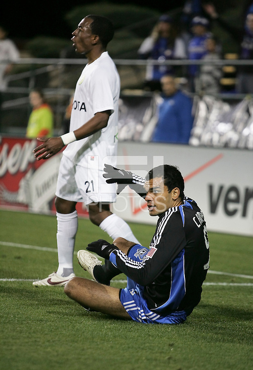 Pablo Campos (9) looks for the call against Cameron Dunn (21). San Jose Earthquakes defeated Portland Timbers 1-0 at Buck Shaw Stadium in Santa Clara, California on March 14th, 2009.