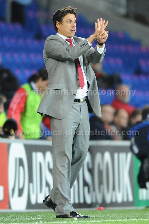 Cardiff City Stadium, Friday 11th Oct 2013. Hand signals to his players from Wales manager Chris Coleman during the Wales v Macedonia FIFA World Cup 2014 Qualifier match at Cardiff City Stadium, Cardiff, Friday 11th Oct 2014. All images are the copyright of Jeff Thomas Photography-07837 386244-www.jaypics.photoshelter.com