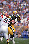 Green Bay Packers quarterback Brett Favre (4) looks for a receiver during an NFL football game against the Cincinnati Bengals at Lambeau Field on September 20, 1992 in Green Bay, Wisconsin. The Packers defeated the Bengals 24-23. (Photo by David Stluka)