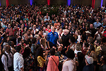 Fr. Holtschneider stands surrounded by hundreds of faculty and staff members who attended the University Picnic to say farewell and give him a warm send off as he leaves DePaul University after serving 13 years as president. (DePaul University/Jeff Carrion)