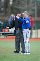 Seton Hall Pirates head coach Rob Sheppard (40) has a discussion with home pate umpire Greg Howard during the game against the Virginia Cavaliers at The Ripken Experience on February 28, 2015 in Myrtle Beach, South Carolina.  The Cavaliers defeated the Pirates 4-1.  (Brian Westerholt/Four Seam Images)