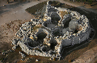 Aerial view of the Ggantija Temples (Giants' Tower), c. 3600-2500 BC, Gozo, Malta, pictured on June 7, 2008, in the morning. The Republic of Malta consists of seven islands in the Mediterranean Sea of which Malta, Gozo and Comino have been inhabited since c.5,200 BC. It has been ruled by Phoenicians (Malat is Punic for safe haven), Greeks, Romans, Fatimids, Sicilians, Knights of St John, French and the British, from whom it became independent in 1964. Nine of Malta's important historical monuments are UNESCO World Heritage Sites, including these Neolithic temples which are probably the site of a fertility cult, and are the earliest of a series of megalithic temples. They are amongst the world's oldest manmade religious structures, although according to legend they were built by a giantess. Picture by Manuel Cohen.