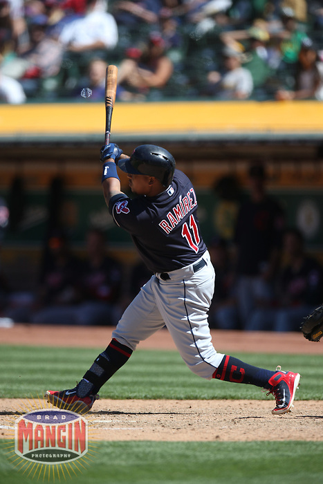OAKLAND, CA - JUNE 30:  Jose Ramirez #11 of the Cleveland Indians bats against the Oakland Athletics during the game at the Oakland Coliseum on Saturday, June 30, 2018 in Oakland, California. (Photo by Brad Mangin)