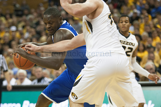 Kentucky Wildcats forward Julius Randle (30) drives past the Missouri defender during the game between the University of Kentucky men's basketball team and University of Missouri in Columbia, Mo.,on Saturday, February 1, 2014. Kentucky defeated Missouri 84-79. Photo by Michael Reaves | Staff