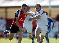 Photo: Richard Lane/Richard Lane Photography. .IRB Junior World Championship. England U20 v Canada U20. 10/06/2008. England's Joe Simpson is tackled by Canada's Conor Trainor.
