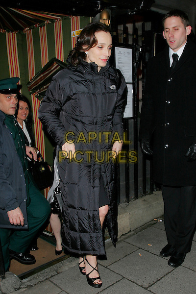 KRISTIN SCOTT THOMAS .The Finch & Partners' Chanel Pre-BAFTA Party held at Annabel's, London, England..February 7th, 2009.full length black dress puffa jacket long heels.CAP/AH.©Adam Houghton/Capital Pictures.