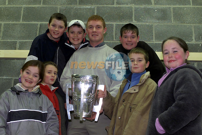 Louise Hynes, Donal Ryan, Cathal Ryan and kate Fanning (Back) Cathal Tuite, Sean Campion and Niall Burke with eamon Corcoran and the Liam McCarthy Cup in St Feckins Clubhouse..Picture Fran Caffrey Newsfile.