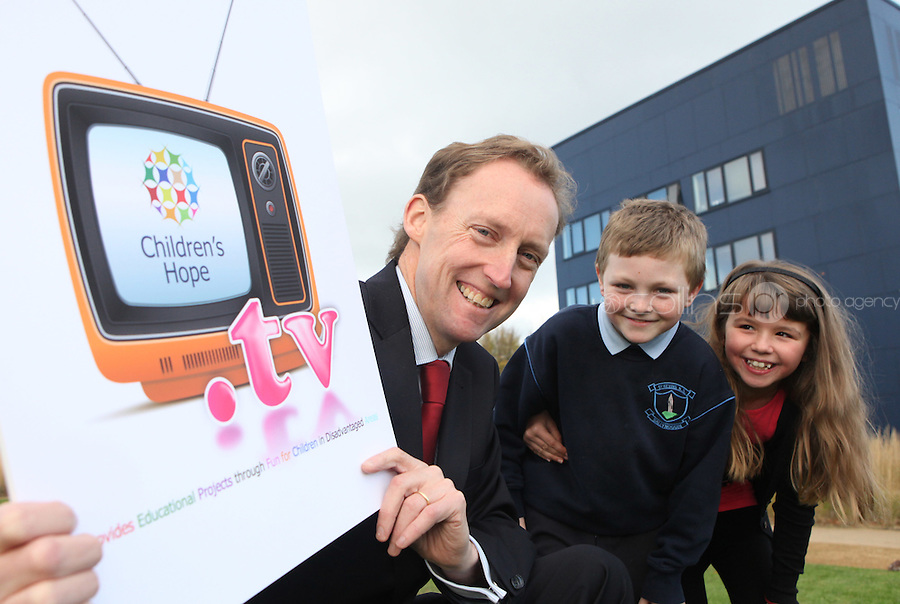 ***NO FEE PIC***.15/11/2010.Minister for Children Barry Andrews TD .Paul Fitzpatrick (9) from Sallynoggin.Kim Mulvaney (8) from Sallynoggin.at the launch of Children's Hope.TV at The Media Cube, IADT,Dun Laoghaire, Co. Dublin..The Irish children's Charity Children's Hope has developed an online educational resource for young people & youth workers, a website caleed www.childrens-hope.tv..The websitte features short curriculm-adhering educational programmes available to be played by young people in after-school projects geared to Youth & Comunity Leaders..Photo: Gareth Chaney Collins