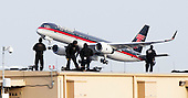 United States President-elect Donald Trump's plane, a Boeing 757-200, departs from LaGuardia Airport as police officers on a rooftop are seen in the foreground in New York, New York, USA, 08 December 2016.<br /> Credit: Justin Lane / Pool via CNP