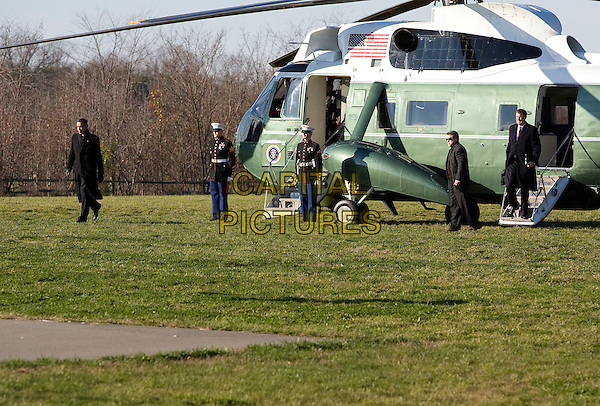United States President Barack disembarks Marine One in Landover, Maryland on his way to attend the 112th Army-Navy Football game at FedEx Field, Landover, Maryland, USA..December 10th, 2011.full length helicopter black coat.CAP/ADM/KT.©Kristoffer Tripplaar/Pool/CNP/AdMedia/Capital Pictures.
