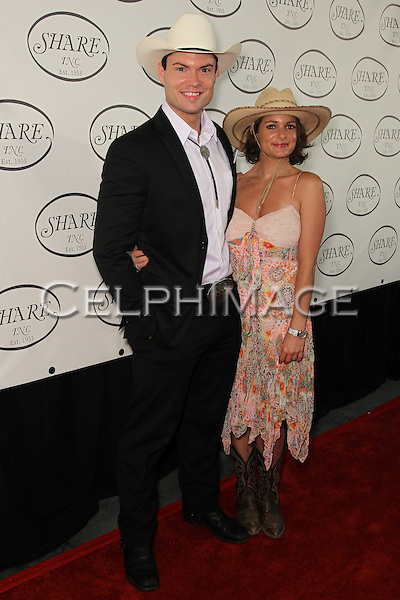 "SAM HORRIGAN, NICOLE SWANSON. Red Carpet arrivals to the 57th Annual Boomtown Event, sponsored by SHARE (Share Happily And Reap Endlessly), honoring actress Jamie Lee Curtis with the ""Shining Spirit Award."" Santa Monica, CA, USA. June 5, 2010."