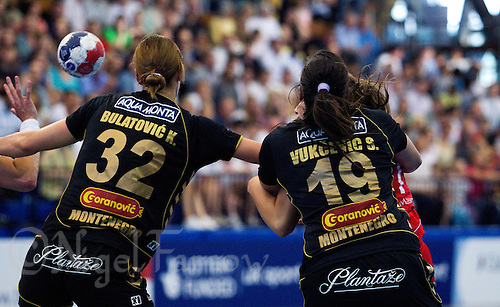 30 MAY 2012 - LONDON, GBR - Katarina Bulatovic (MNE) (left) and Sara Vukcevic (MNE) (right), both of Montenegro defend during the 2012 European Handball Championship qualification match against Great Britain at the National Sports Centre in Crystal Palace, Great Britain  (PHOTO (C) 2012 NIGEL FARROW)