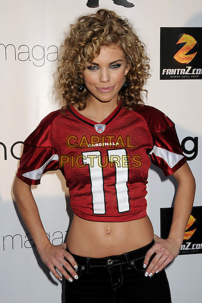 ANNALYNNE McCORD.2nd Annual Game Day at the Playboy Mansion, Los Angeles, California, USA..February 1st, 2009.half length red crop cropped top belly stomach midriff 11 eleven hands on hip.CAP/ADM/BP.©Byron Purvis/AdMedia/Capital Pictures.