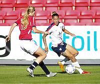 Marit Fiane Christensen (19) defends Natasha Kai (6). USA 4,  Norway 0, Fredrikstad Stadium, July 2, 2008.