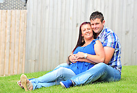 swansea..news...thursday 10th july 2014...<br /> <br /> Susan Davies and Marcus O'Keefe from Aberavon celebrating their recent engagement.Marcus proposed by writing in the sand on Aberavon beach.