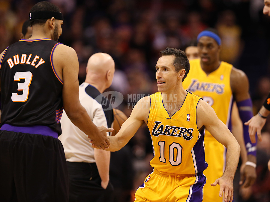 Jan. 30, 2013; Phoenix, AZ, USA: Los Angeles Lakers guard Steve Nash (10) greets Phoenix Suns forward Jared Dudley at the US Airways Center. Mandatory Credit: Mark J. Rebilas-