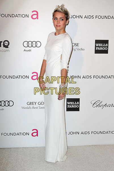 Miley Cyrus (wearing Azzaro).The 21st Annual Elton John AIDS Foundation Academy Awards Viewing Party held at The City of West Hollywood Park in West Hollywood, California, USA..February 24th, 2013.oscars full length dress white long sleeves diamond bracelets .CAP/ADM/KB.©Kevan Brooks/AdMedia/Capital Pictures.
