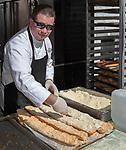Bob Osborn makes gailic bread during the Italian Festival in downtown Reno on Saturday, Oct. 8, 2017.