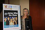 One Life To Live Kristen Alderson and poster at 18th Annual Feast to benefit Center for Hearing and Communications (CHC) on October 24, 2011 at Chelsea Pier 60, New York City, New York. (Photo by Sue Coflin/Max Photos)