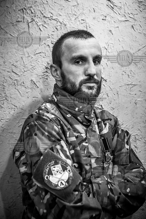 A combat veteran who took part in the Maidan protests in a coffee shop in the city centre.
