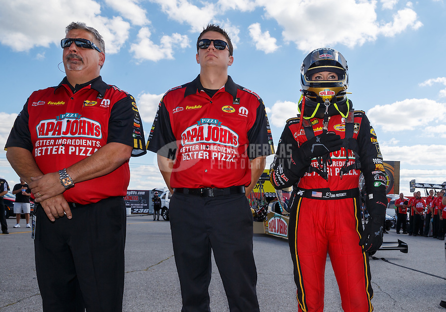Sep 3, 2016; Clermont, IN, USA; NHRA top fuel driver Leah Pritchett stands alongside crew members during the national anthem prior to qualifying for the US Nationals at Lucas Oil Raceway. Mandatory Credit: Mark J. Rebilas-USA TODAY Sports
