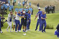 Thorbjorn Olesen (Team Europe)Tyrrell Hatton (Team Europe) Francesco Molinari (Team Europe) and the rest of the European Team jumps on Alex Noran (Team Europe) celebrating his win on the 18th during the singles matches at the Ryder Cup, Le Golf National, Ile-de-France, France. 30/09/2018.<br /> Picture Fran Caffrey / Golffile.ie<br /> <br /> All photo usage must carry mandatory copyright credit (&copy; Golffile | Fran Caffrey)