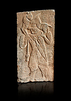 Pictures & images of the North Gate Hittite sculpture stele depicting Hittite man with a sheep on his shoulders. 8th century BC. Karatepe Aslantas Open-Air Museum (Karatepe-Aslantaş Açık Hava Müzesi), Osmaniye Province, Turkey. Against black background