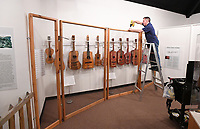 Curtis Moris, exhibit manager at the Shiloh Museum, takes down an display about guitars Monday Jan. 13, 2020. A new exhibit about the history of Greek life at the University of Arkansas is expected to be up in early February. For information about the museum go to https://shilohmuseum.org/. Visit nwaonline.com/200114Daily/ for today's photo gallery. (NWA Democrat-Gazette/J.T. Wampler)