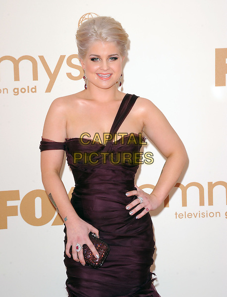 Kelly Osbourne (wearing J Mendel).The 63rd Annual Primetime Emmy Awards held at Nokia Theatre L.A. Live in Los Angeles, California, USA..September  18th, 2011.emmys half length dress purple plum one off the shoulder hand on hip clutch bag.CAP/RKE/DVS.©DVS/RockinExposures/Capital Pictures.