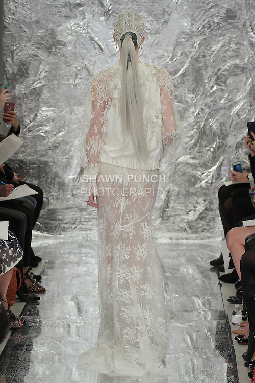 Model Caitlin Lyon walks runway in Trinity - an ivory stain back crepe and Chantilly lace souvenir jacket over Chantilly lace skirt, from the Theia Spring 2017 bridal collection by Don O'Neill, during New York Bridal Fashion Week Spring Summer 2017 on April 14, 2016.