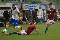 Kostas Fortounis (L) of Greece and Attila Fiola (R) of Hungary fight for the ball during the UEFA Nations' League qualifying match between Hungary and Greece at the Groupama Arena stadium in Budapest, Hungary on Sept. 11, 2018. ATTILA VOLGYI