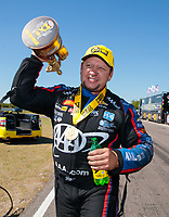 Apr 14, 2019; Baytown, TX, USA; NHRA funny car driver Robert Hight celebrates after winning the Springnationals at Houston Raceway Park. Mandatory Credit: Mark J. Rebilas-USA TODAY Sports