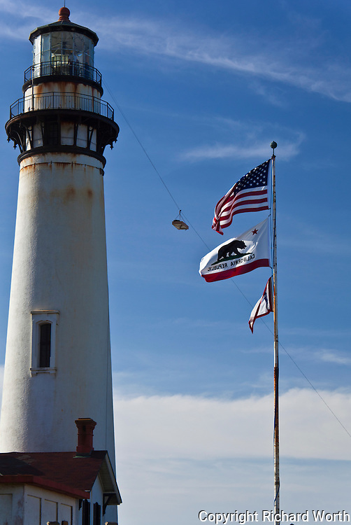 Sections of the Fresnel lens from atop Pigeon Point Lighthouse have been carefully bundled and are suspended in midair on a zipline, headed to the ground during restoration of the historic light station.